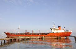 Cargo ship in a harbor Royalty Free Stock Photography
