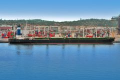 Cargo ship in harbor Stock Photography