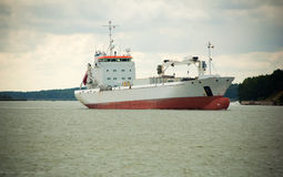 Cargo ship in harbor Stock Image