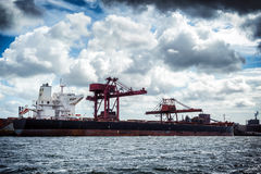 Cargo ship in harbor Stock Photos