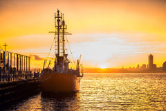 Cargo ship in the harbor at commercial port at sunset time Royalty Free Stock Photography