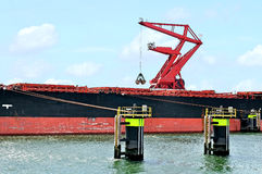 Cargo ship and harbor crane Royalty Free Stock Photography