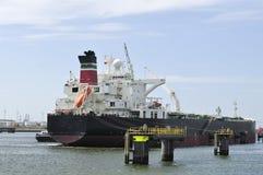 Cargo ship and harbor crane royalty free stock photos