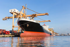 Cargo ship in the harbor for logistic import export background.  Royalty Free Stock Photos