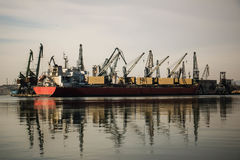 Cargo ship into harbor, shipyards. Varna Bulgaria Royalty Free Stock Photography