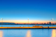 Cargo ship in the harbor at sunset Stock Photo