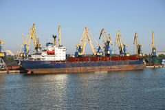 Cargo ship in harbour. Royalty Free Stock Images