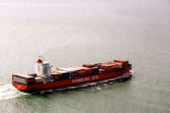 Cargo ship heading off Stock Photos