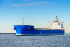 Cargo ship heading to open sea Royalty Free Stock Photo