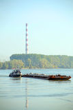 Cargo ship and heating plant at the Danube Royalty Free Stock Photography