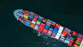Cargo ship in import export and business logistic, Logistic and. Transportation of International Container Cargo ship in the open sea, Aerial shot from drone Stock Images