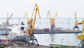 Cargo ship and Industrial cranes Royalty Free Stock Photography