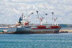 Cargo ship inside harbor Royalty Free Stock Image