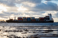 Free Cargo Ship Is Leaving Port Sailing Away Royalty Free Stock Photos - 82895898