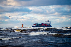 Free Cargo Ship Is Leaving Port Sailing Away Royalty Free Stock Photography - 82895907