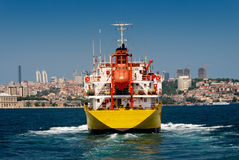 A cargo ship in Istanbul. Crossing the bosporus Stock Images