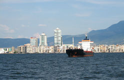 Cargo ship at Izmir. 's bay and Izmir on background Royalty Free Stock Image
