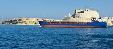 Ship leaves the harbor. Cargo ship leaves the harbor of Valletta Stock Photography