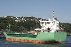 Cargo Ship leaving dock Stock Photography