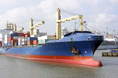 Cargo ship leaving harbor. Cargo ship leaving the harbor of Rotterdam in the Netherlands Royalty Free Stock Photos