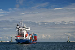 Cargo ship leaving the harbor Stock Image