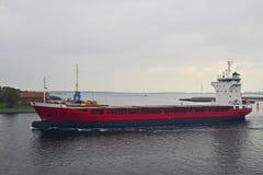 Cargo ship leaving harbor Stock Photos