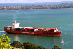 Cargo ship leaving the harbour Royalty Free Stock Image