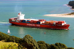 Cargo ship leaving the harbour Royalty Free Stock Photos