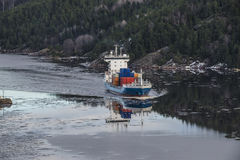 Cargo ship leaving the ringdalsfjord Stock Photography