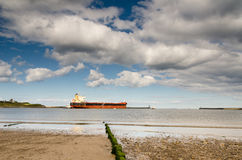 Cargo ship leaving the River Tyne Stock Photo