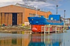 Cargo Ship on lift Stock Image