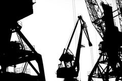 Cargo ship-lifting cranes on the river  in the port (black-and-white photo) Royalty Free Stock Photo