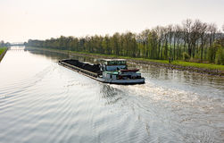 Cargo ship loaded with coal on the canal in Wesermarsch Stock Photo