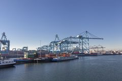 Cargo ship loading containers by crane in the morning , Trade Port , Shipping, Rotterdam stock photography