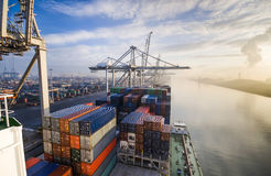 Free Cargo Ship Loading Containers In Rotterdam. Royalty Free Stock Photo - 53654065