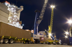 Cargo ship loading containers by night. Royalty Free Stock Photos