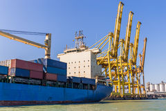 Cargo Ship Loading Containers Stock Photo