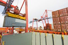 Cargo ship loading containers in Rotterdam. Royalty Free Stock Photography