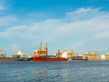 Cargo ship loading containers on schedule. Stock Images