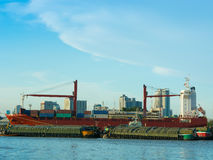 Cargo ship loading containers on schedule. Royalty Free Stock Images