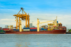 Cargo ship loading containers on schedule. Royalty Free Stock Photography