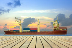 Cargo ship loading containers on schedule. Royalty Free Stock Photos