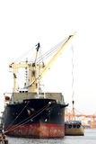 Cargo ship loading crate Stock Photography