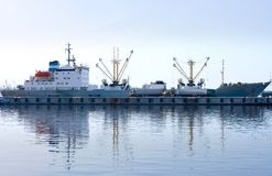 Cargo ship loading in port Stock Image