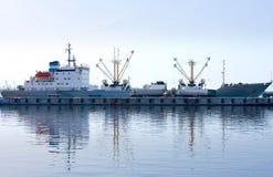 Cargo ship loading in port. A cargo ship loading in port Stock Image