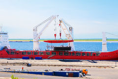 Cargo ship loading at the port Royalty Free Stock Images