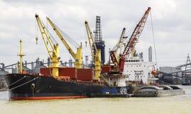 Cargo ship loading in the port. Stock Image