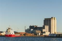 Cargo ship loading pulpwood Kalmar Sweden Royalty Free Stock Photography