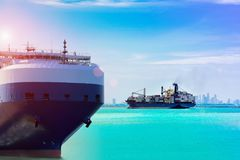 Cargo ship. Logistics and Transportation of international Container Cargo ship and Cargo plane in the sea on sunset blue sky Stock Photos