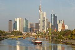Cargo Ship on Main River and Frankfurt Skyline. A cargo ship on the Main River and Frankfurt's Skyline n the background. Frankfurt is the financial center of Stock Photography